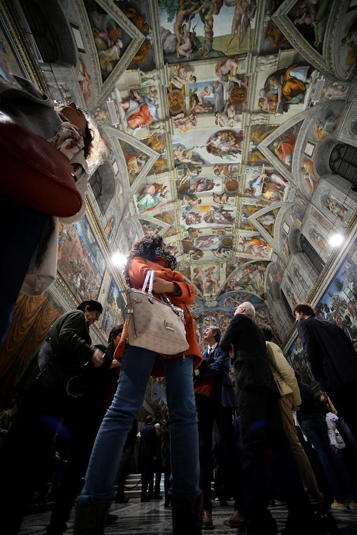 The Sistine Chapel's new lighting system, seen at a press opening on October 29, 2014, cost some three million euros ($3.77 million) (AFP Photo/Filippo Monteforte)