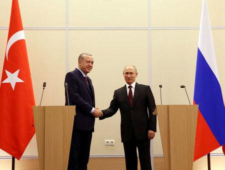 Turkish President Tayyip Erdogan and his Russian counterpart Vladimir Putin attend a news conference in Sochi, Russia, November 13, 2017. Yasin Bulbul/Presidential Palace/Handout via REUTERS