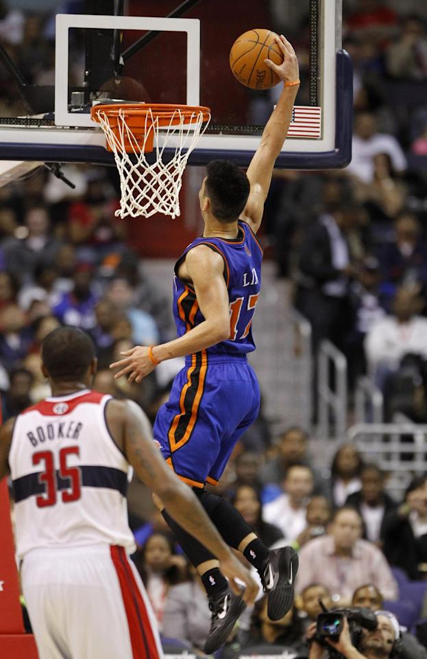 New York Knicks point guard Jeremy Lin (17) goes up for a dunk in front of Washington Wizards forward Trevor Booker (35) during the second half of an NBA basketball game, Wednesday, Feb. 8, 2012, in Washington. The Knicks won 107-93. (AP Photo/Haraz N. Ghanbari)