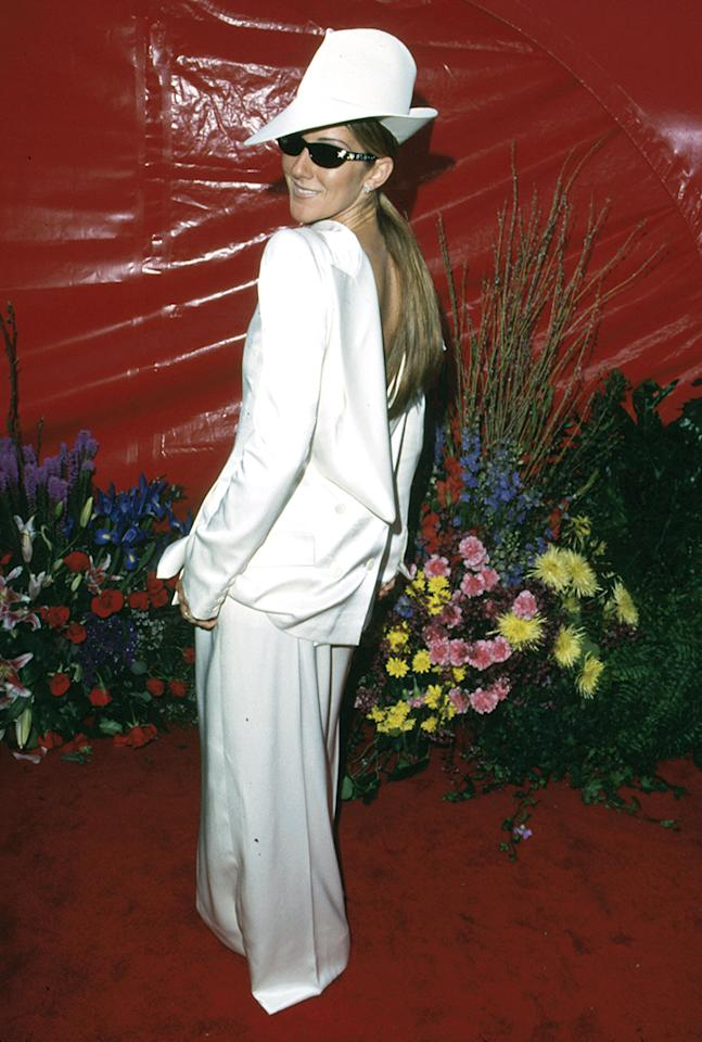 Celine Dion, 1999. The Canadian singer may have been able to get away with a John Galliano white tuxedo. Wearing it backward might have even been considered a clever twist. But that flouncy hat looked like the Wicked Witch of the West's chapeau after a bleach incident. All together, she looked like she was going the wrong way to an all-white funeral procession .