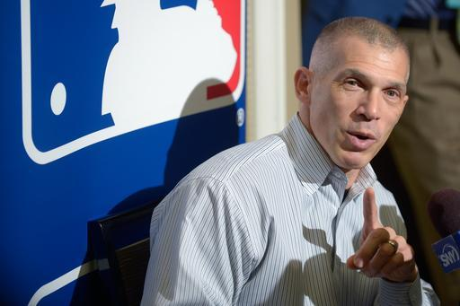 New York Yankees manager Joe Girardi answers a question from reporters during a media availability at baseball's winter meetings in Lake Buena Vista, Fla., Tuesday, Dec. 10, 2013.(AP Photo/Phelan M. Ebenhack)