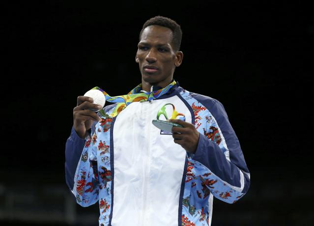 2016 Rio Olympics - Boxing - Victory Ceremony - Men's Light Welter (64kg) Victory Ceremony - Riocentro - Pavilion 6 - Rio de Janeiro, Brazil - 21/08/2016. Silver medallist Collazo Sotomayor (AZE) of Azerbaijan poseds with his medal. REUTERS/Peter Cziborra FOR EDITORIAL USE ONLY. NOT FOR SALE FOR MARKETING OR ADVERTISING CAMPAIGNS.