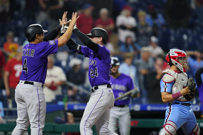 Colorado Rockies' Colton Welker, left, and Ryan McMahon, center, celebrate after McMahon's two-run home run against Philadelphia Phillies pitcher Ian Kennedy during the ninth inning of a baseball game, Thursday, Sept. 9, 2021, in Philadelphia. (AP Photo/Matt Slocum)