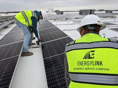 A snapshot of the EnergyLink team installing a utility scale solar array at MidwayUSA, one of many large commercial energy projects EnergyLink has become a part of in 2021.