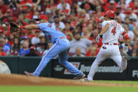 St. Louis Cardinals' Paul Goldschmidt, left, catches the throw as Cincinnati Reds' Shogo Akiyama (4) reaches first base safely during the second inning of a baseball game in Cincinnati, Saturday, July 24, 2021. (AP Photo/Aaron Doster)