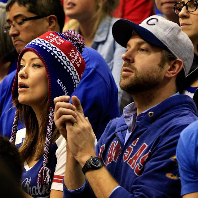 Olivia Wilde and Jason Sudeikis watch from the crowd during the game between the American University Eagles and the Kansas Jayhawks at Allen Fieldhouse on December 29, 2012 in Lawrence, Kansas. (Photo by Jamie Squire/Getty Images)
