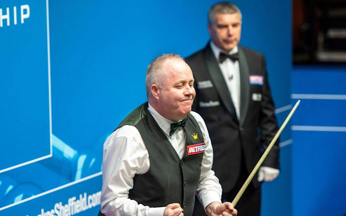 John Higgins celebrates the 10th 147 of his career - John Higgins hits first Crucible 147 of his career - and tournament's first since 2012 - SHUTTERSTOCK