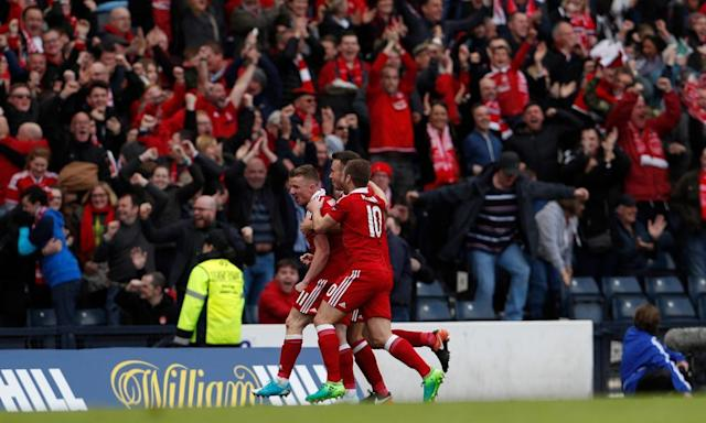 """<span class=""""element-image__caption"""">Aberdeen's Jonathan Hayes is congratulated by team-mates after his shot was deflected in for the decisive own goal, scored by Hibernian's Darren McGregor.</span> <span class=""""element-image__credit"""">Photograph: Lee Smith/Reuters</span>"""