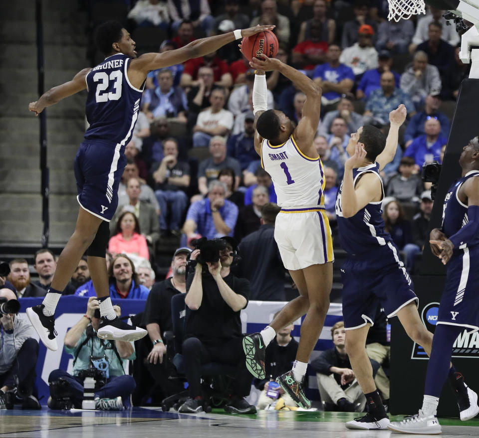 <p>Yale forward Jordan Bruner (23) blocks a shot attempt by LSU's Javonte Smart (1) during the second half of a first round men's college basketball game in the NCAA Tournament, in Jacksonville, Fla. Thursday, March 21, 2019. (AP Photo/John Raoux) </p>