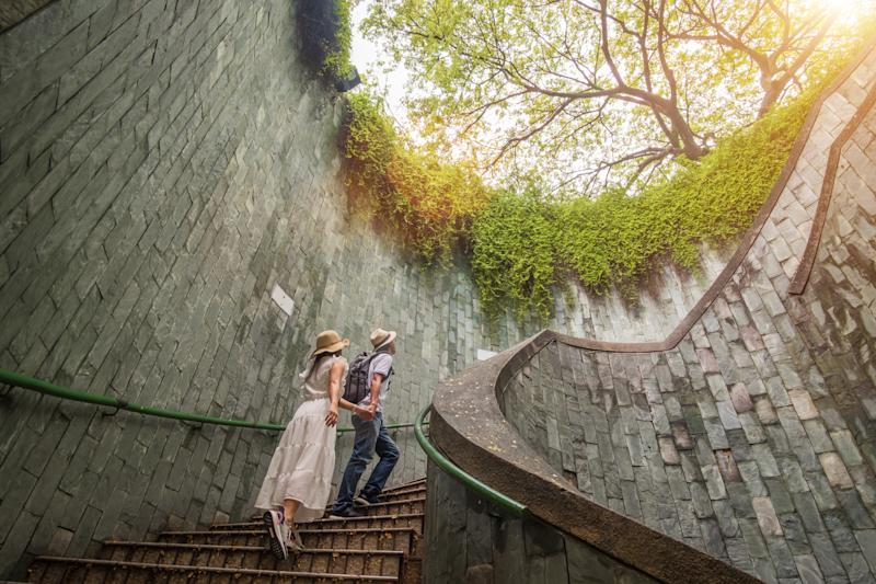 A couple exploring the underground spiral staircase at Fort Canning Park. (PHOTO: Getty Images)