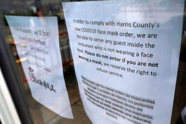 PHOTO: A sign about the new face mask order is posted on the door of a closed restaurant, June 25, 2020, in Houston. (David J. Phillip/AP)