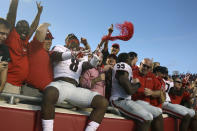 Georgia linebacker Shaun McGee (8) celebrates with fans after an NCAA college football game in Little Rock, Ark., Saturday, Oct. 18, 2014. Georgia defeated Arkansas 45-32. (AP Photo/Danny Johnston)