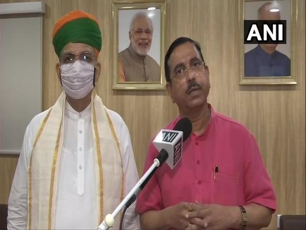 Union Minister of Coal and Mines Pralhad Joshi (In Red) talking to ANI (Photo/ANI)