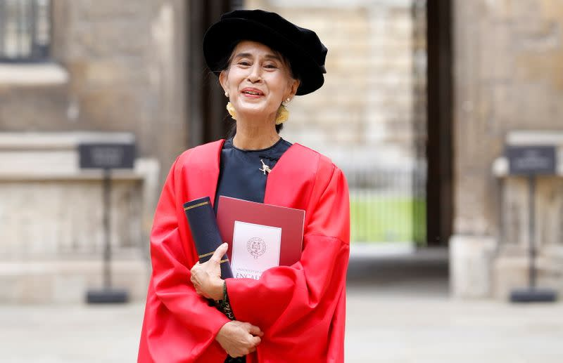 FILE PHOTO: Myanmar pro-democracy leader Aung San Suu Kyi poses for a photograph after receiving her honorary degree at Oxford University, in Oxford