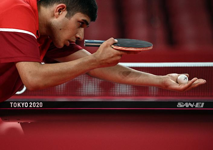 <p>USA's Kanak Jha competes aginst Russia's Kirill Skachkov during his men's singles round 2 table tennis match at the Tokyo Metropolitan Gymnasium during the Tokyo 2020 Olympic Games in Tokyo on July 26, 2021. (Photo by Anne-Christine POUJOULAT / AFP)</p>
