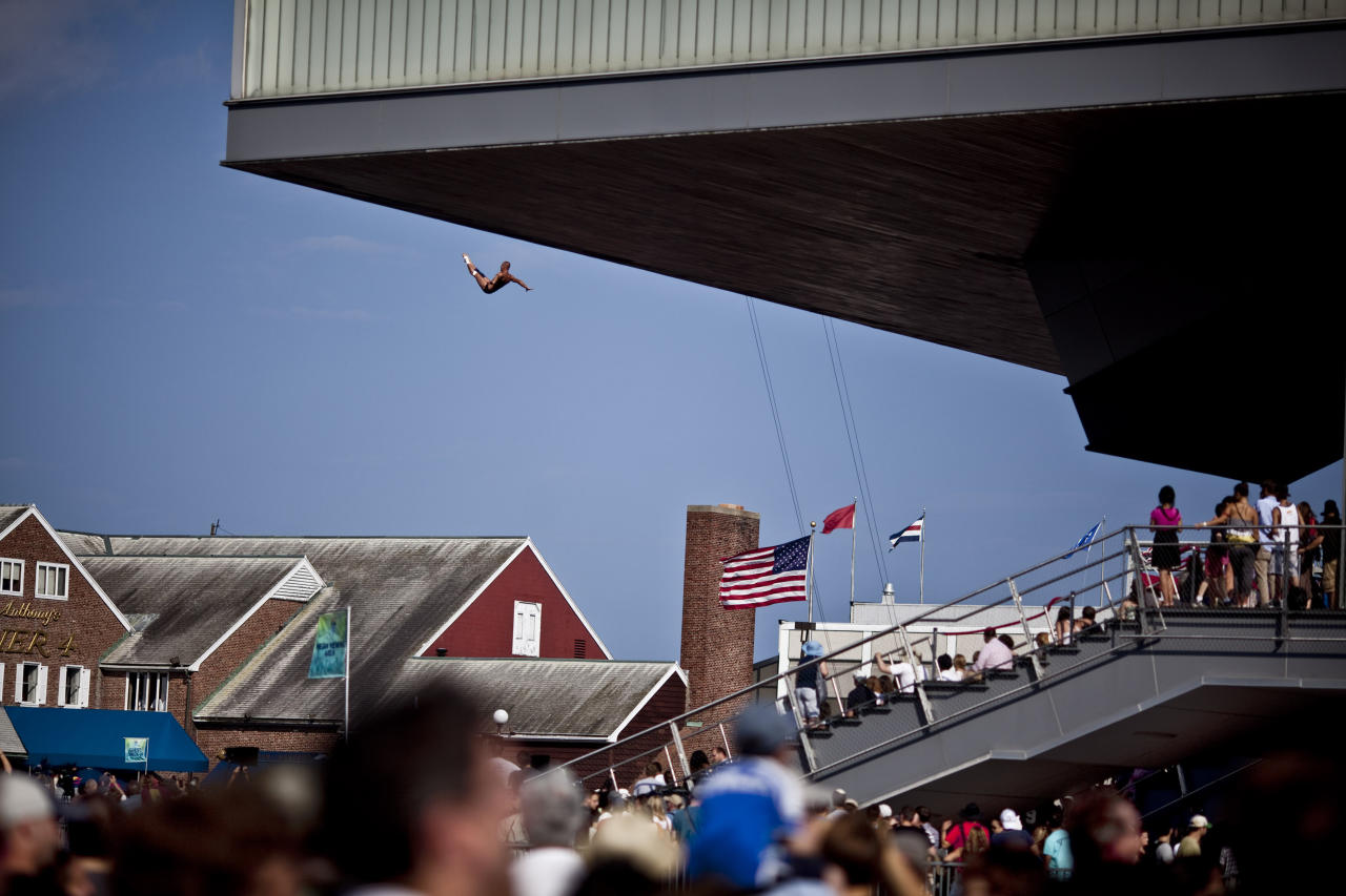 """HANDOUT RESTRICTED TO EDITORIAL USE AND EDITORIAL SALES - MANDATORY CREDIT """"AFP PHOTO / RED BULL / Romina AMATO""""  This handout photo received by Red Bull and taken on August 20, 2011 shows Artem Silchenko of Russia as he dives from the 26.5 metre platform on the Institute of Contemporary Art building during the sixth stop of the Red Bull Cliff Diving World Series at Fan Pier in Boston. Gary Hunt of Great Britain has an almost unassailable lead with one stop in the series remaining in Yalta, Ukraine, in two weeks.  AFP PHOTO / HO / RED BULL / Romina AMATO (Photo credit should read Romina AMATO/AFP/Getty Images)"""