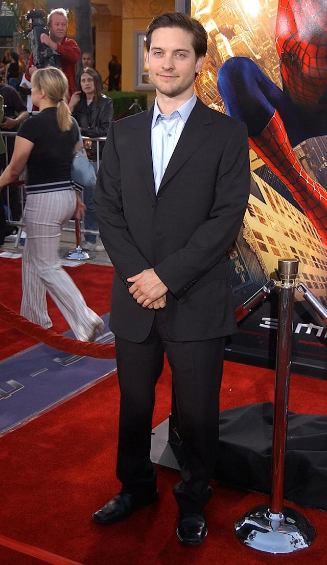 <p>Tobey Maguire launched Sony's<em> Spider-Man</em> franchise, playing the hero and his nerdy alter ego, Peter Parker, in the critically acclaimed film helmed by Sam Raimi. He is pictured here arriving to the Los Angeles premiere on April 29, 2002. (Photo: Robert Mora/Getty Images) </p>