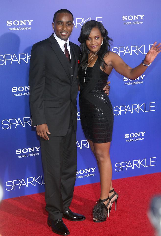 """HOLLYWOOD, CA - AUGUST 16:  Bobbi Kristina Brown (R) and Nick Gordon  arrive at the Los Angeles Premiere of """"Sparkle"""" at Grauman's Chinese Theatre on August 16, 2012 in Hollywood, California.  (Photo by Maury Phillips/Getty Images For A+E Networks)"""