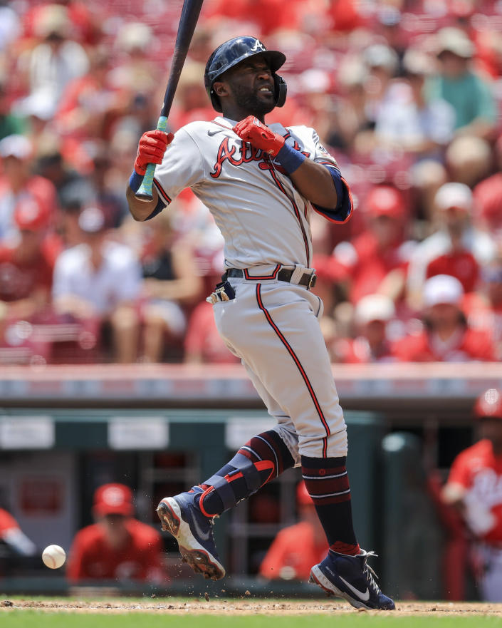 Atlanta Braves' Guillermo Heredia reacts after being hit by a pitch from Cincinnati Reds' Tyler Mahle during the third inning of a baseball game in Cincinnati, Sunday, June 27, 2021. (AP Photo/Aaron Doster)