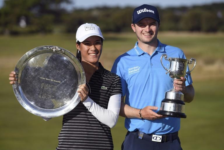 Celine Boutier of France and David Law of Scotland hold their trophies after winning respectively the LPGA Tour and European Tour Vic Open titles in 2019