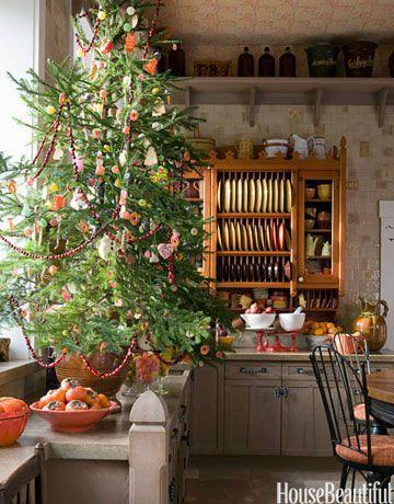 <p>This evergreen is covered entirely with edible decorations, like cookies, ribbon candy, gumdrops, and garlands of popcorn and cranberries.</p>