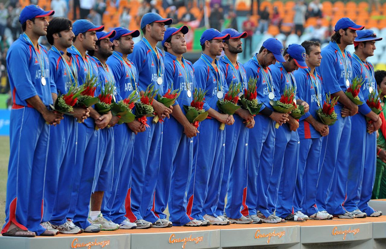 Silver medalist cricket team of Afghanistan attend the medal ceremony of the cricket finals at the 16th Asian Games in Guangzhou on November 26, 2010. Bangladesh won the gold medal, Afghanistan got the silver and Pakistan settled for the bronze.    AFP PHOTO / Saeed Khan (Photo credit should read SAEED KHAN/AFP/Getty Images)