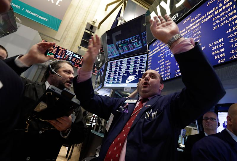 Specialist Peter Giacchi, right, calls out prices at the closing bell on the floor of the New York Stock Exchange Thursday, Feb. 28, 2013. The stock market pushed higher Thursday afternoon, sending the Dow tantalizingly close to a record high. (AP Photo/Richard Drew)