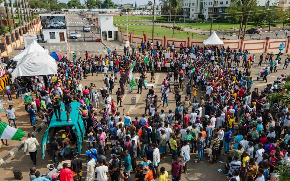 Protesters gather at the front of Alausa, the Lagos State Secretariat - AFP
