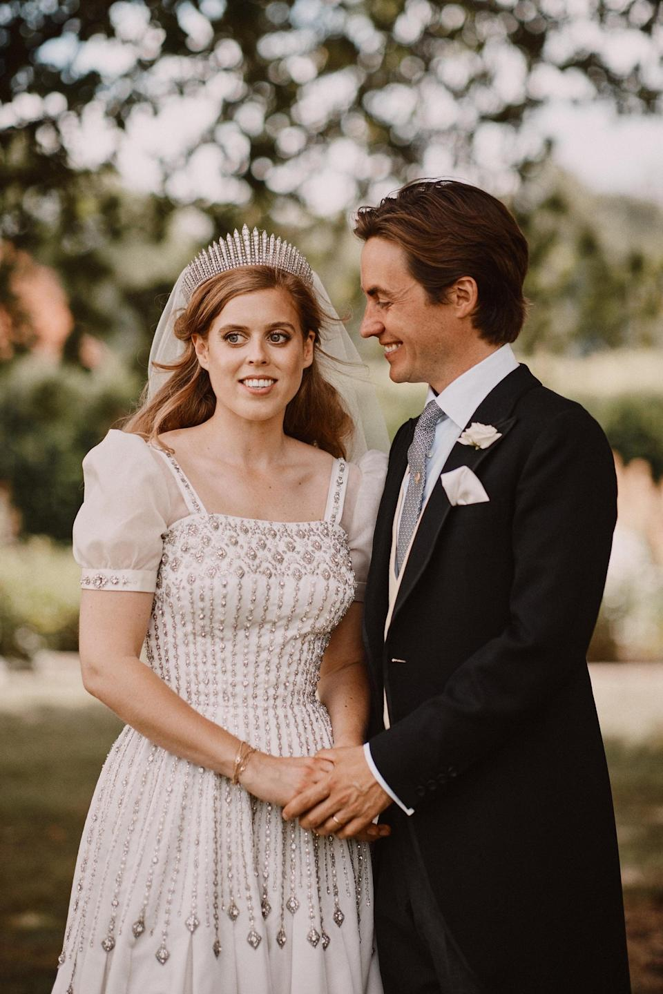 WINDSOR, UNITED KINGDOM - JULY 18: NEWS EDITORIAL USE ONLY. NO COMMERCIAL USE. NO MERCHANDISING, ADVERTISING, SOUVENIRS, MEMORABILIA or COLOURABLY SIMILAR. NOT FOR USE AFTER 18th January 2021 WITHOUT PRIOR PERMISSION FROM BUCKINGHAM PALACE. NO CROPPING. In this handout image released by the Royal Communications, Princess Beatrice and Edoardo Mapelli Mozzi are photographed after their wedding in the grounds of Royal Lodge on July 18, 2020 in Windsor, United Kingdom. (Photo by Benjamin Wheeler via Getty Images) Copyright in the photograph is vested in Princess Beatrice and Edoardo Mapelli Mozzi and Benjamin Wheeler. Publications are asked to credit the photograph to Benjamin Wheeler. No charge should be made for the supply, release or publication of the photograph. The photograph must not be digitally enhanced, manipulated or modified in any manner or form and must include all of the individuals in the photograph when published. NOTE TO EDITORS: This handout photo may only be used in for editorial reporting purposes for the contemporaneous illustration of events, things or the people in the image or facts mentioned in the caption. Reuse of the picture may require further permission from the copyright holder.