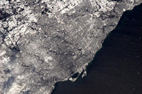 Toronto in snow - how it looked from the ISS today, 30 Dec at 12:35 local.