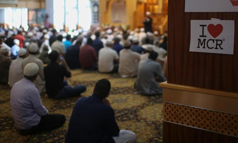 Muslims attend Friday prayers at a mosque in Manchester.