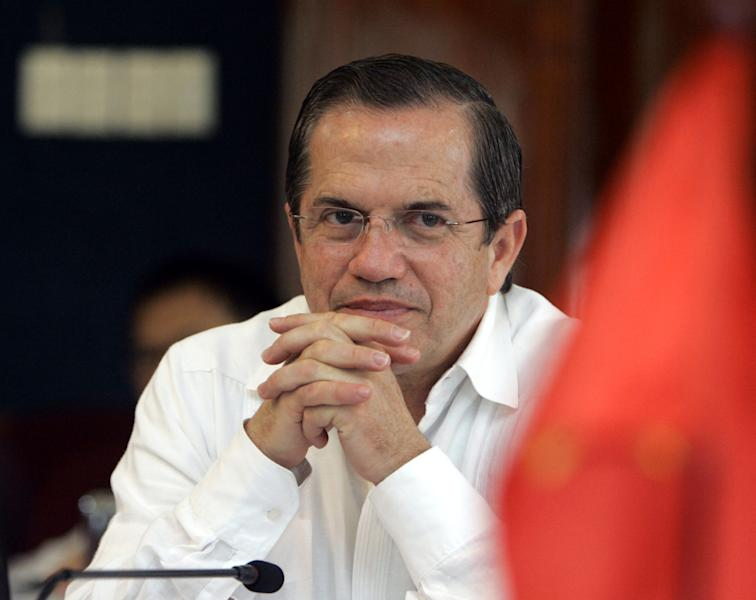 Ecuador's Foreign Mister Ricardo Patino listens to an official during his visit to a high tech park in Hanoi, Vietnam , Tuesday, June 25, 2013. Patino said he doesn't know where Edward Snowden is or what travel documents the National Security Agency leaker might be using. (AP Photo/Tran Van Minh)