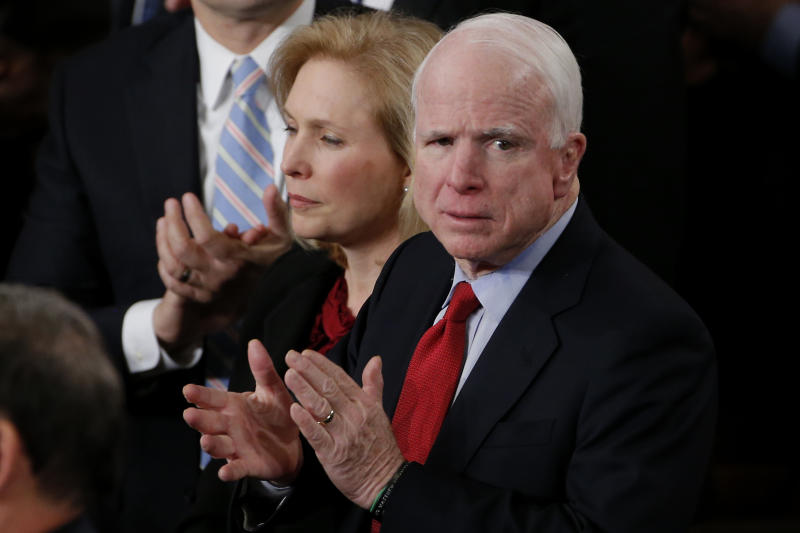 Sen. Kirsten Gillibrand, D-N.Y., and Sen. John McCain, R-Ariz. applaud President Barack Obama's State of the Union address on Capitol Hill in Washington, Tuesday Jan. 28, 2014. (AP Photo/Charles Dharapak)