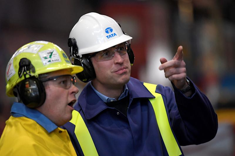 Britain's Prince William, Duke of Cambridge (R) wears a hard hat and protective clothes as he speaks with Works Manager Carl Banfield during his visit to the Tata Steel plant in Port Talbot, south Wales on February 4, 2020. (Photo by TOBY MELVILLE / POOL / AFP) (Photo by TOBY MELVILLE/POOL/AFP via Getty Images)