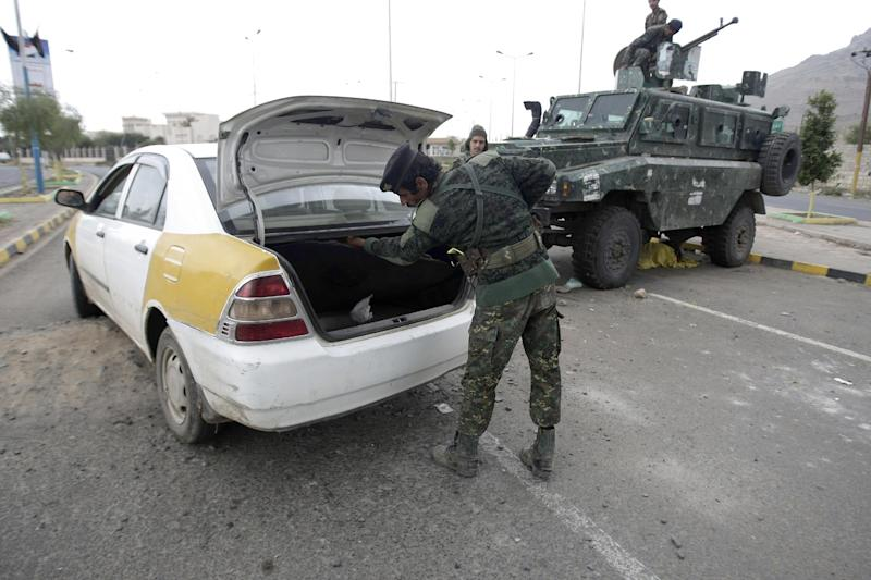 "A policeman checks a car at a checkpoint near the U.S. embassy in Sanaa, Yemen, Tuesday, Aug. 6, 2013. The State Department on Tuesday ordered non-essential personnel at the U.S. Embassy in Yemen to leave the country. The department said in a travel warning that it had ordered the departure of non-emergency U.S. government personnel from Yemen ""due to the continued potential for terrorist attacks"" and said U.S. citizens in Yemen should leave immediately because of an ""extremely high"" security threat level. (AP Photo/Hani Mohammed)"