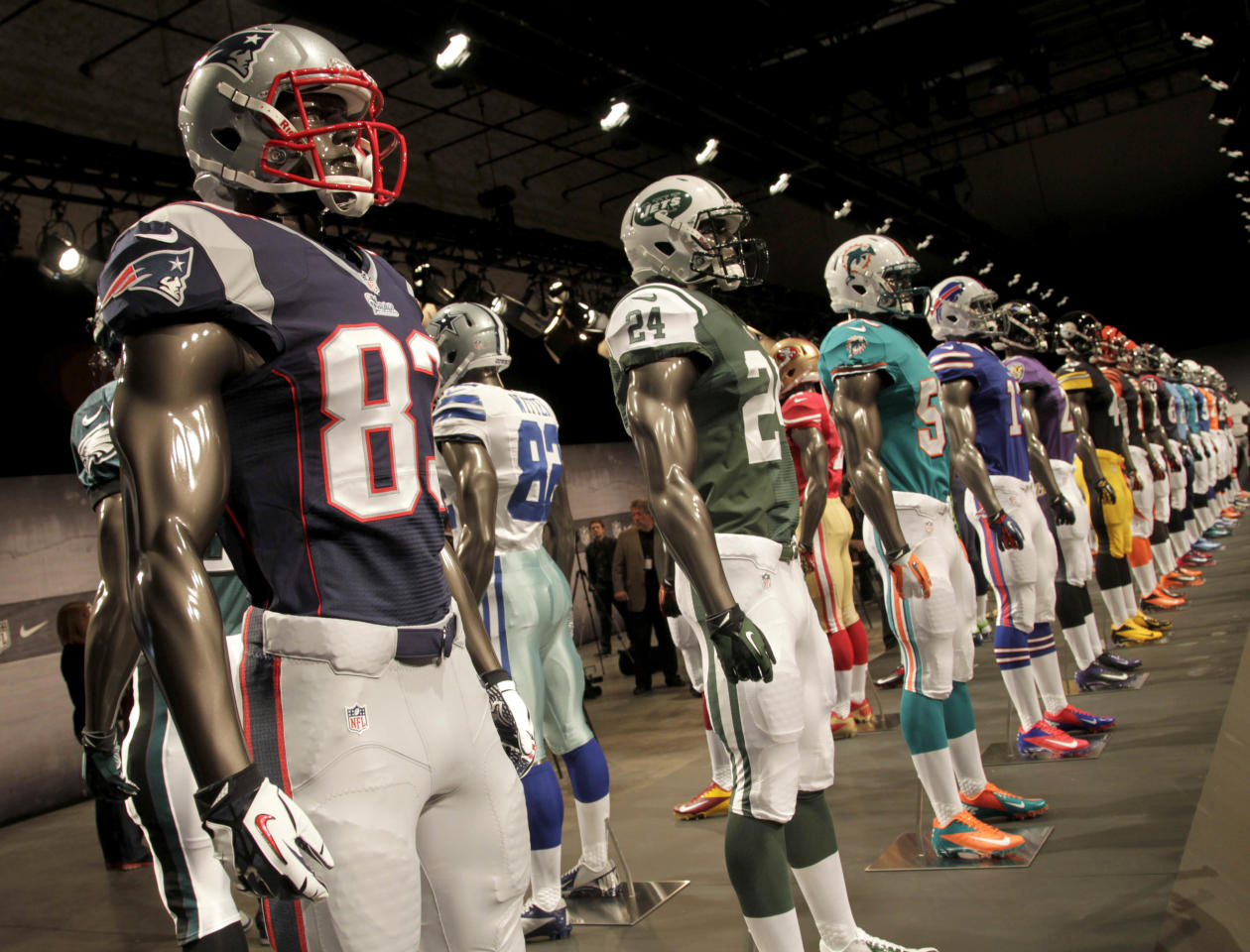 New NFL uniforms are displayed on mannequins during a presentation in New York, Tuesday, April 3, 2012. The NFL and Nike showed off the new look in grand style with a gridiron-styled fashion show at a Brooklyn film studio. (AP Photo/Seth Wenig)