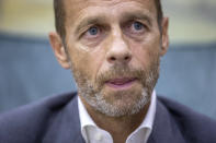 UEFA President Aleksander Ceferin speaks during an interview with The Associated Press in Lisbon, Portugal, Sunday, Aug. 23, 2020. Ceferin says he will hold talks about retaining the single-game eliminator format that has been used to complete the pandemic-disrupted Champions League and Europa League seasons. (AP Photo/Manu Fernandez)