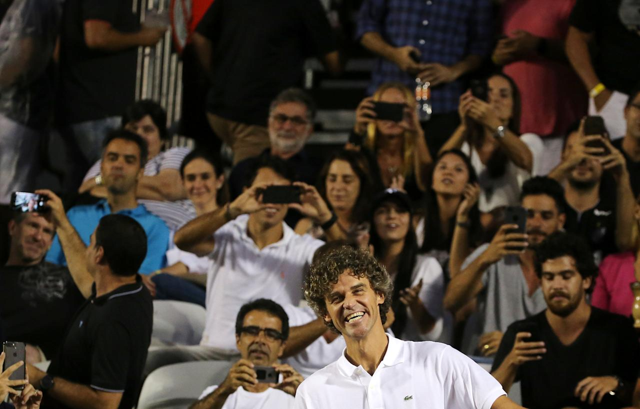 Tennis - ATP 500 - Rio Open - Quarterfinal - Rio de Janeiro, Brazil - February 23, 2018 Former tennis player Gustavo Kuerten reacts to fans during the match between Gael Monfils of France and Diego Schwartzman of Argentina. REUTERS/Sergio Moraes