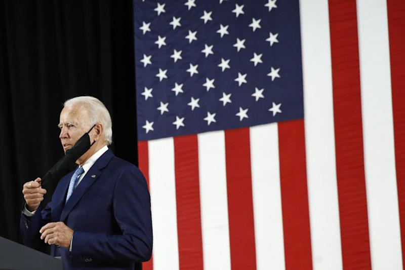 Democratic presidential candidate, former Vice President Joe Biden removes a face mask to protect against the spread of the new coronavirus as he arrives to speak at Alexis Dupont High School in Wilmington, Del., Tuesday, June 30, 2020. (AP Photo/Patrick Semansky)