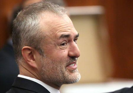 Nick Denton, founder of Gawker, talks with his legal team before Terry Bollea, aka Hulk Hogan, testifies in court, in St Petersburg, Florida