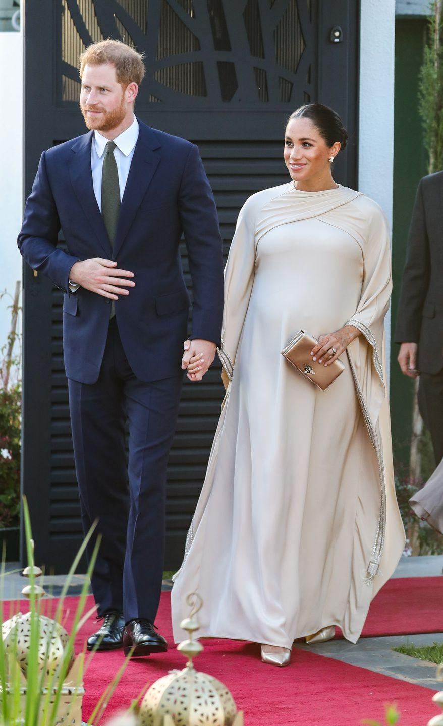 "<p>The royal couple <a href=""https://www.townandcountrymag.com/style/fashion-trends/g3272/meghan-markle-preppy-style/"" rel=""nofollow noopener"" target=""_blank"" data-ylk=""slk:looked stylish"" class=""link rapid-noclick-resp"">looked stylish</a> as they arrived holding hands to <a href=""https://www.townandcountrymag.com/society/tradition/g26364847/prince-harry-and-meghan-markle-morocco-2019-visit-photos/"" rel=""nofollow noopener"" target=""_blank"" data-ylk=""slk:a reception at the British residency in Morocco"" class=""link rapid-noclick-resp"">a reception at the British residency in Morocco</a>. </p>"