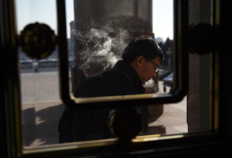 China has more than 300 million smokers, who consume more than a third of the world's annual cigarette production (AFP Photo/Greg Baker)
