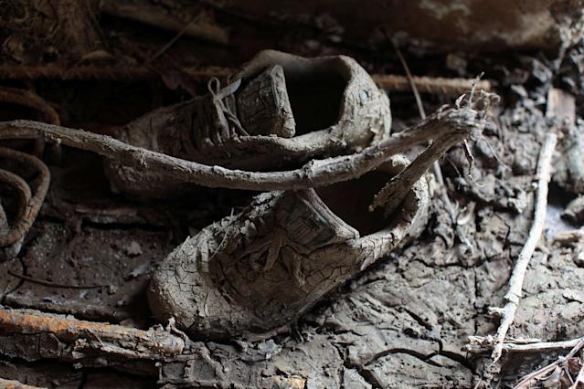 <p>A pair of shoes are seen inside a house filled with mud, after the island was hit by Hurricane Maria in Toa Baja, Puerto Rico, Oct. 16, 2017. (Photo: Alvin Baez/Reuters) </p>
