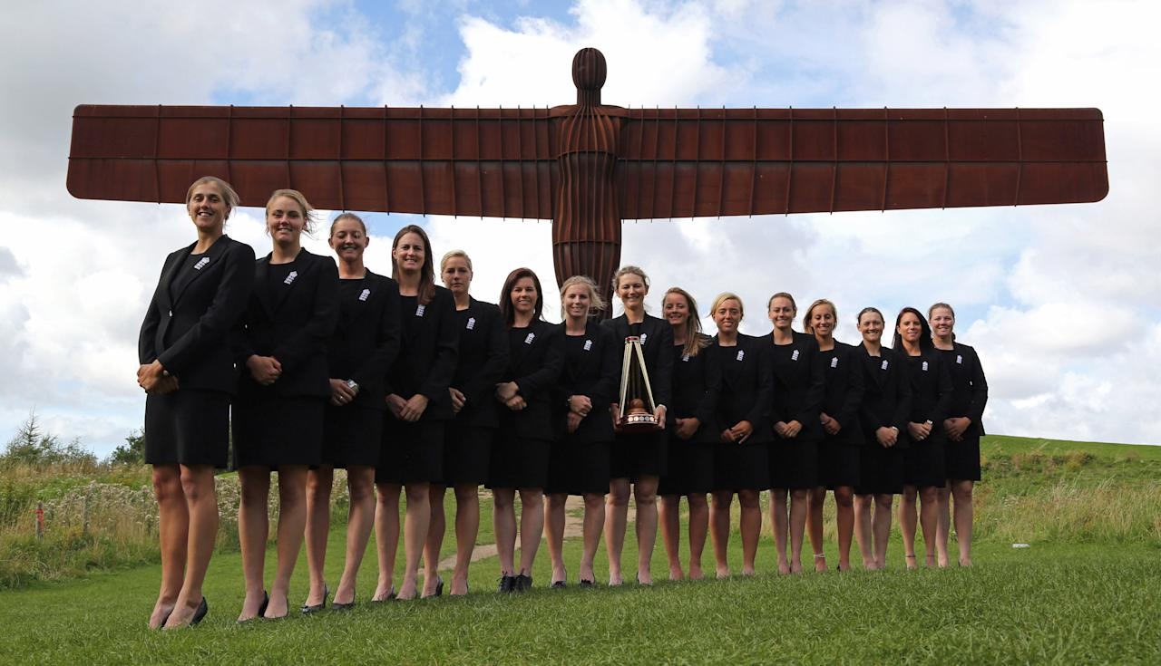 GATESHEAD, ENGLAND - AUGUST 31: The England Women squad celebrate their Women's Ashes win during a photo opportunity at The Anthony Gormley 'Angel of the North' sculpture on August 31, 2013 in Gateshead, England. (Photo by Ian Horrocks/Getty Images)