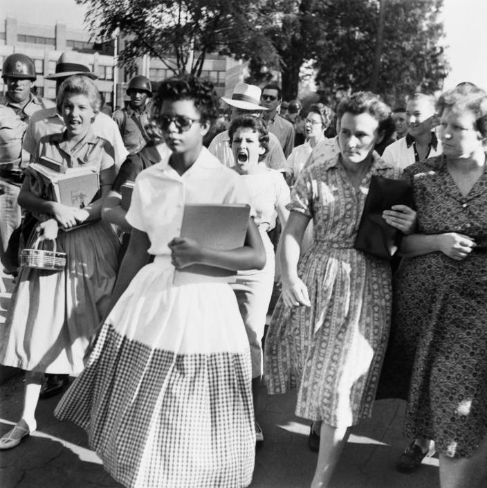 <p>Students of Central High School in Little Rock, Ark., shout insults at Elizabeth Eckford as she marches down to a line of National Guardsmen, who blocked the main entrance and would not let her enter, on Sept. 4, 1957. She was one of the nine African-American students whose integration into Central High School was ordered by a Federal Court following legal action by NAACP. (Photo: Bettmann/Getty Images) </p>