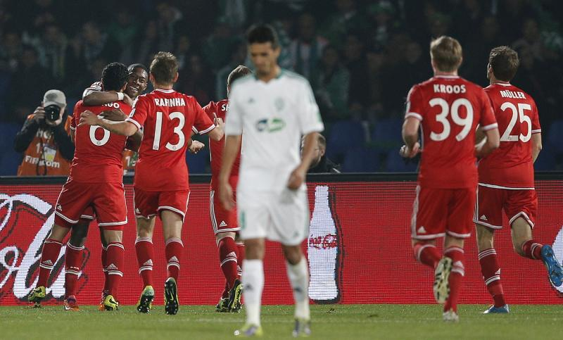 Bayern's Thiago Alcantara, 2nd left, celebrates after scoring his sides 2nd goal during the final of the soccer Club World Cup between FC Bayern Munich and Raja Casablanca in Marrakech, Morocco, Saturday, Dec. 21, 2013. (AP Photo/Christophe Ena)