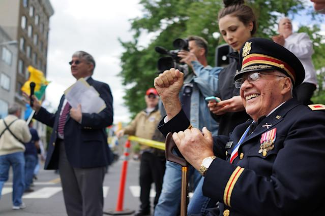 WATERBURY, CT - MAY 26: Korean War veteran John Chiarella watches as the Memorial Day Parade passes on May 26, 2013 in Waterbury, Connecticut. Memorial Day is a federal holiday in America and has been celebrated since the end of the Civil War. Waterbury, once a thriving industrial city with one of the largest brass manufacturing bases in the world, has suffered economically in recent decades as manufacturing jobs have left the area. (Photo by Spencer Platt/Getty Images)