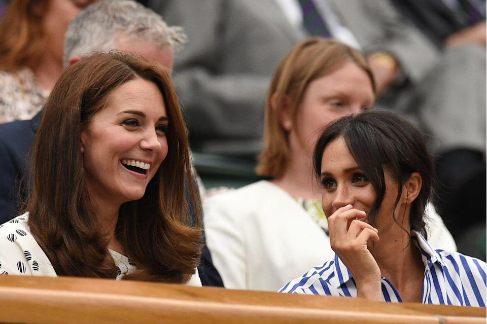"""<p>Meghan and Kate spent their first joint outing together watching Serena Williams compete at the women's finals in 2018. <a href=""""https://www.townandcountrymag.com/style/fashion-trends/g22147037/kate-middleton-meghan-markle-first-outing-photos-together-wimbledon/"""" rel=""""nofollow noopener"""" target=""""_blank"""" data-ylk=""""slk:See more photos of their day at the tournament here."""" class=""""link rapid-noclick-resp"""">See more photos of their day at the tournament here.</a> </p>"""
