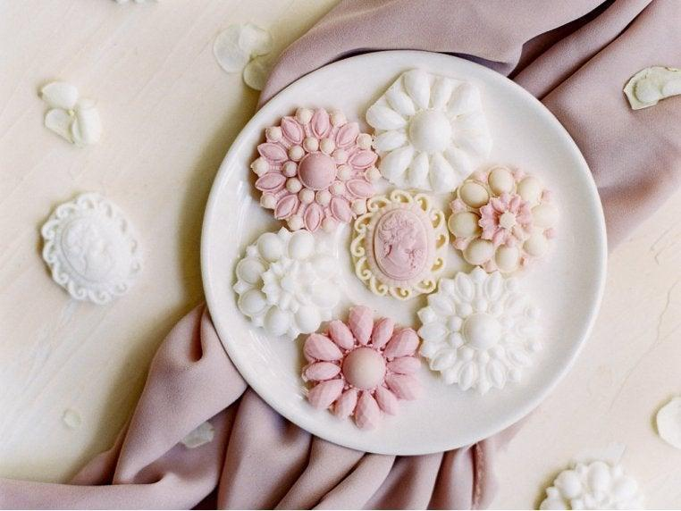 """<h2>Decorative Brooch Soap Set</h2><br><strong>Best For: Grandparents<br>Budget: $18</strong><br>Instead of something edible, you consider these hand-poured moisturizing bathing brooches made from shea butter and goat's milk — a usable decoration that'll make them think of you whenever they see it. <br><br><em>Shop <strong><a href=""""https://www.thegrommet.com/gifts/by-price/under-25"""" rel=""""nofollow noopener"""" target=""""_blank"""" data-ylk=""""slk:The Grommet"""" class=""""link rapid-noclick-resp"""">The Grommet</a></strong></em><br><br><br><br><strong>A'marie's Bath Flower Shop</strong> Decorative Brooch Soap Set, $, available at <a href=""""https://go.skimresources.com/?id=30283X879131&url=https%3A%2F%2Fwww.thegrommet.com%2Fproducts%2Famaries-bath-flower-shop-decorative-brooch-soap-set"""" rel=""""nofollow noopener"""" target=""""_blank"""" data-ylk=""""slk:The Grommet"""" class=""""link rapid-noclick-resp"""">The Grommet</a>"""