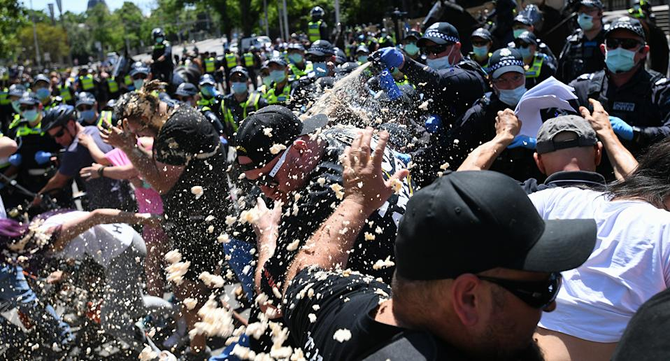 Police use OC spray on protesters during an anti-lockdown protest in Melbourne.